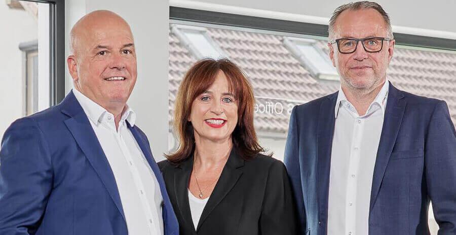 Drei Geschäftsführer von FBS Office Systeme um Rundtisch